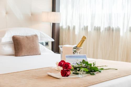 Кровать или кровати в номере Nixe Palace