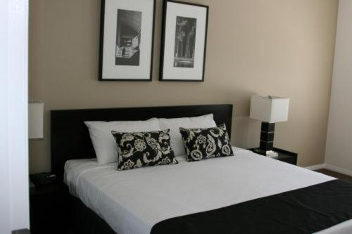 A bed or beds in a room at Chancellor Executive Apartments