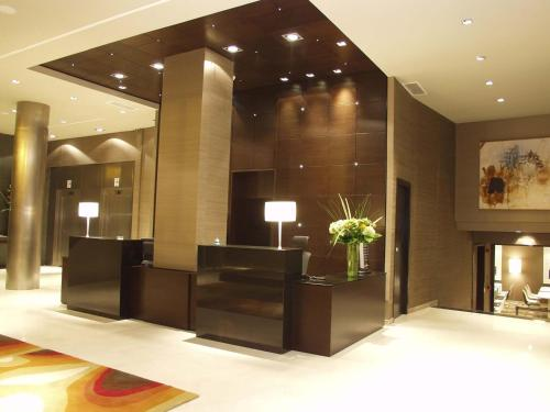 The lobby or reception area at Hotel Conqueridor