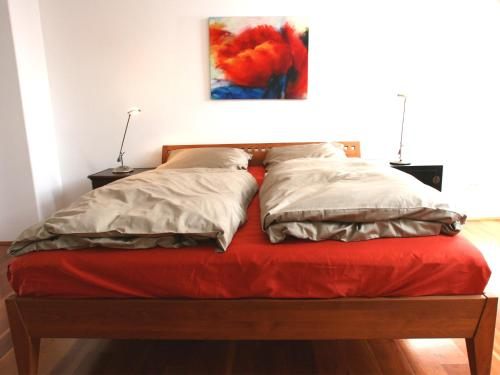 A bed or beds in a room at Apartment Medienhafen