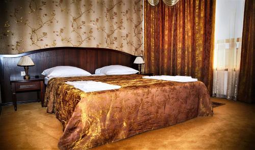 Кровать или кровати в номере Hotel Cafe Premier Krymsk