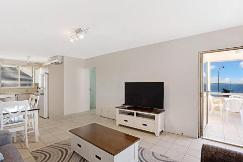 A television and/or entertainment center at Bay Village, Unit 14/ 47 Shoal Bay Road