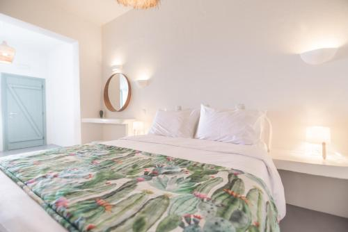 A bed or beds in a room at Agave Santorini Design Boutique Hotel