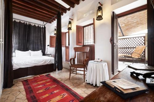 A bed or beds in a room at XVA Art Hotel