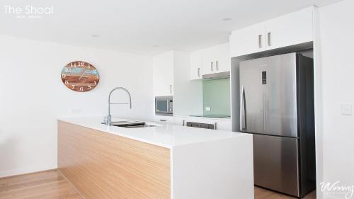 A kitchen or kitchenette at The Shoal Apartments, Unit 202/4-8 Bullecourt Street
