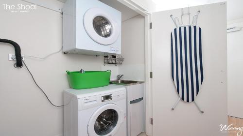 A bathroom at The Shoal Apartments, Unit 202/4-8 Bullecourt Street