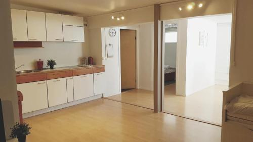 A kitchen or kitchenette at Keflavik Apartment