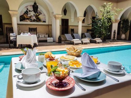 The swimming pool at or near Demeures d'Orient Riad & Spa