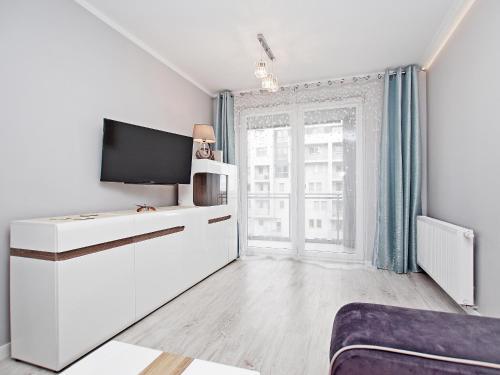Telewizja i/lub zestaw kina domowego w obiekcie Apartament Rajski Park