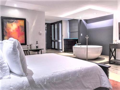Cama o camas de una habitación en NEhotel Nueva Estancia