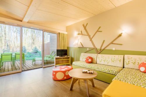 A seating area at Villages Nature Paris at Disneyland® Paris