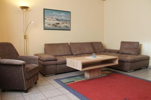 Een zitgedeelte bij Ferienwohnungen im Gästehaus Sieberns