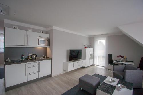 Küche/Küchenzeile in der Unterkunft Apartmenthaus Am Fließ