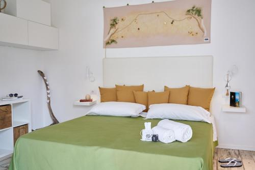 A bed or beds in a room at Tiliguerta Glamping&Camping Village