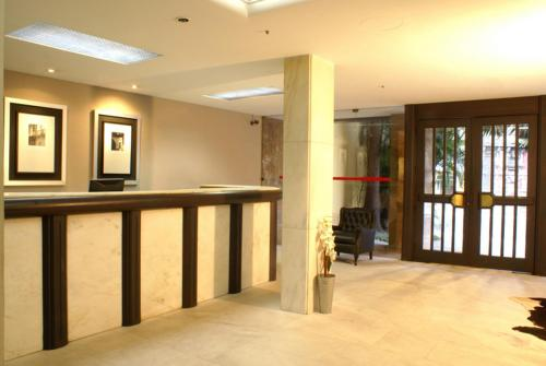 The lobby or reception area at Duque Center Hotel Residence