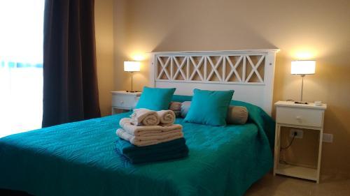 Una cama o camas en una habitación de Merlo Centro Aparts