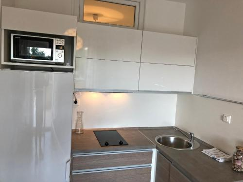 A kitchen or kitchenette at Apartments Nela
