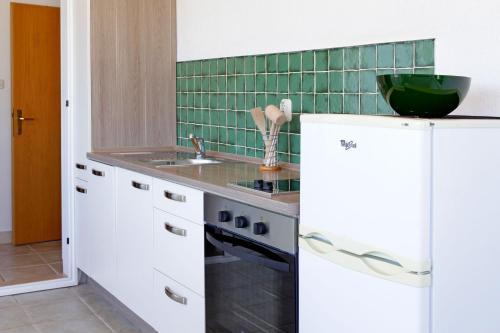 Kuchyň nebo kuchyňský kout v ubytování Apartments Mel