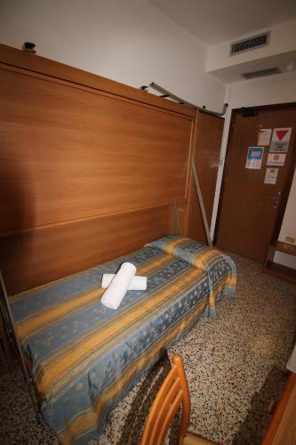Postel nebo postele na pokoji v ubytování Albergo Santa Margherita