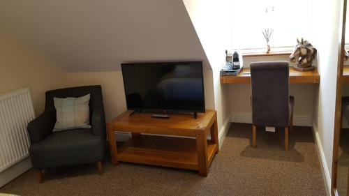 A television and/or entertainment center at The Barn Courtyard