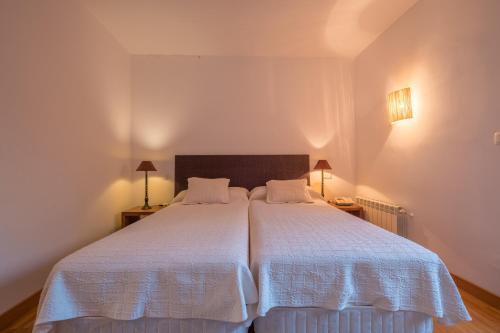 Cama o camas de una habitación en Hotel El Molino de Salinas