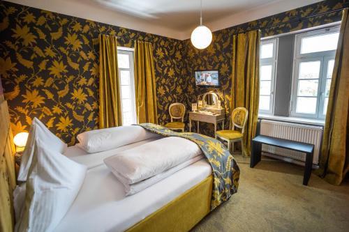 Кровать или кровати в номере Domäne am See