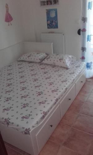 Ένα ή περισσότερα κρεβάτια σε δωμάτιο στο Sithonia Alekos Luxury Experience