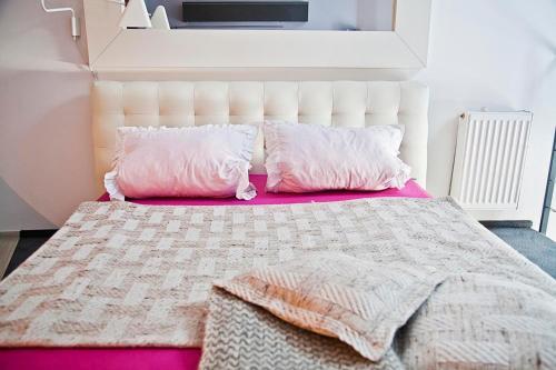 Łóżko lub łóżka w pokoju w obiekcie Loft Suite