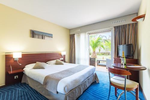 Un ou plusieurs lits dans un hébergement de l'établissement Hotel Brise de Mer - 3 Etoiles