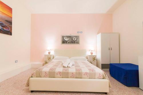 Ein Bett oder Betten in einem Zimmer der Unterkunft Buon Vento