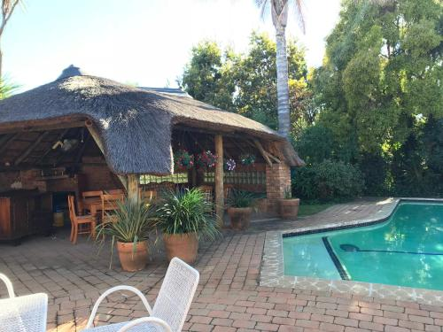 The swimming pool at or close to Celtis Lane Guest House