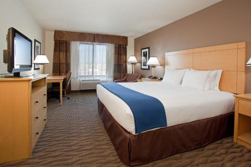A bed or beds in a room at Holiday Inn Express West Valley City