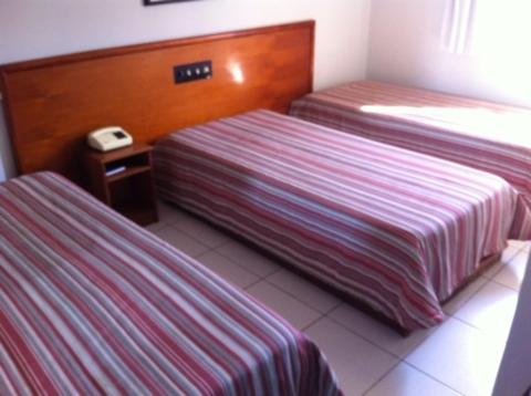 A bed or beds in a room at Villas Boas Hotel