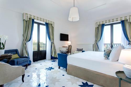 A bed or beds in a room at Anna Belle Elegant AgriResort
