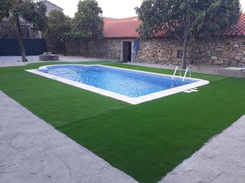 The swimming pool at or near Casa Dos Lagares De Vara E Pedra