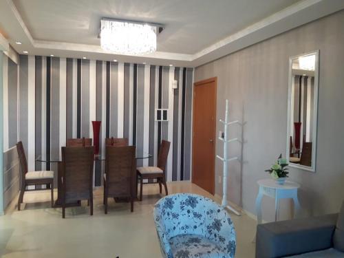 A seating area at Apartamento de alto padrão