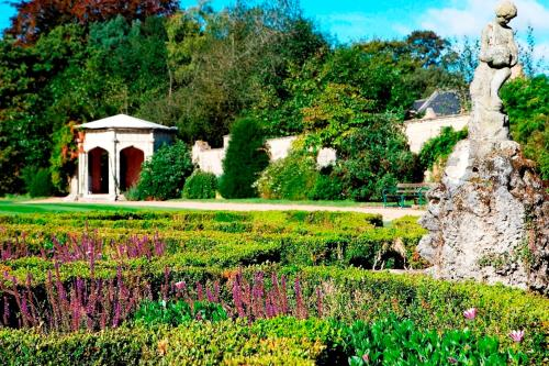 A garden outside Shendish Manor Hotel