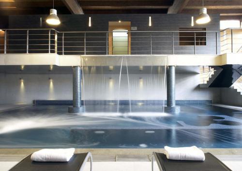 The swimming pool at or near Oca Vila de Allariz Hotel & Spa