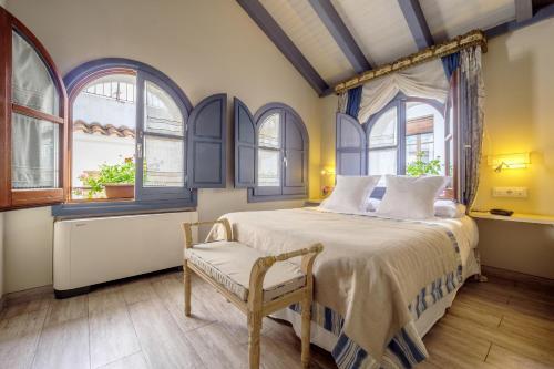 Cama o camas de una habitación en ApartaSuites Alberca Deluxe