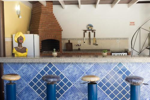 A kitchen or kitchenette at Pousada Cabore