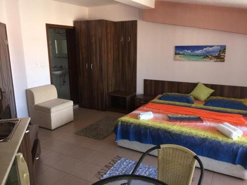 A bed or beds in a room at Sunny House Family Complex