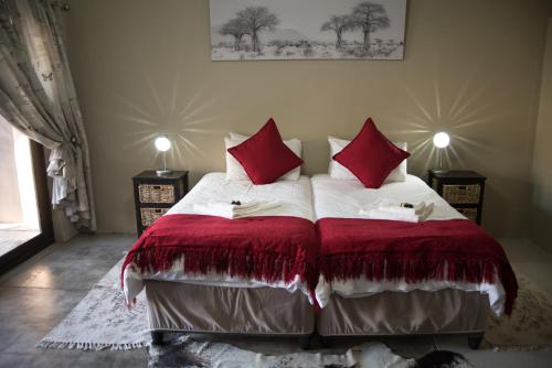 A bed or beds in a room at Koedoeberg Guest Farm