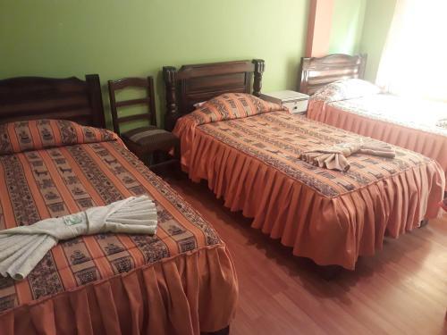 Cama o camas de una habitación en Hostal Luz Yhobimar