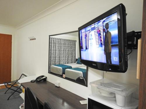 A television and/or entertainment center at Gallery Motel