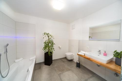 Ein Badezimmer in der Unterkunft Hotel Restaurant Sailer