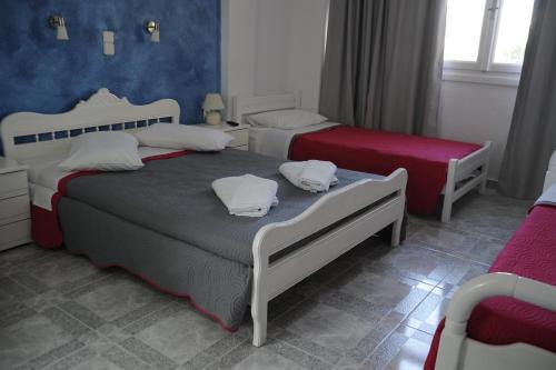 Ένα ή περισσότερα κρεβάτια σε δωμάτιο στο Villa Michalis