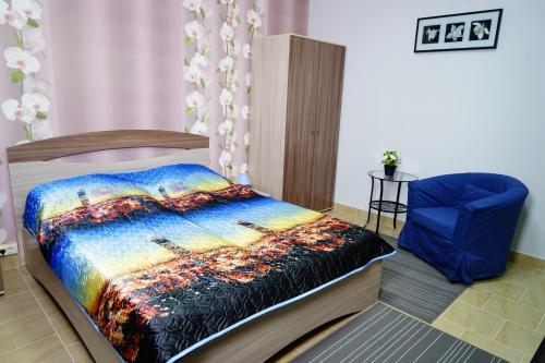 Кровать или кровати в номере Apartamenty Na Sovetskoy