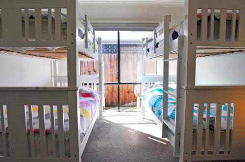 A bunk bed or bunk beds in a room at PLOVERS REST - SURF SIDE