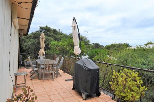 A balcony or terrace at SHANGRI-LA ON SURF PARADE - FREE WIFI!