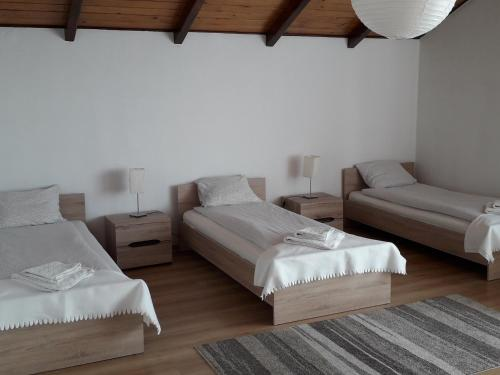 Łóżko lub łóżka w pokoju w obiekcie Villa Osa Modlin Airport